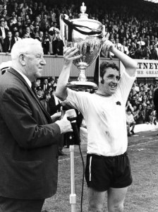 dave-mckay-of-derby-holding-up-the-watney-cup-after-derby-beat-manchester-united-august-1970